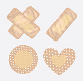 Bandages. For wounds in different ways over white background Royalty Free Stock Images