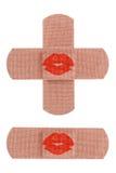 Bandages avec le baiser Photographie stock libre de droits