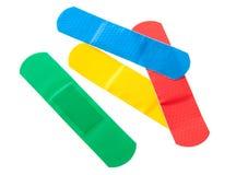 Bandages colorés Images libres de droits