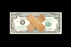 Bandages covering face of one hundred dollar bill Royalty Free Stock Image