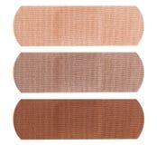 Bandages dans différentes couleurs de la peau Image libre de droits