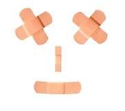 Bandages souriants d'adhésif de visage Images libres de droits