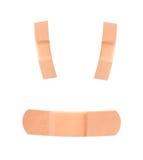 Bandages souriants d'adhésif de visage Photos libres de droits