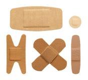 Bandages. Various bandage shapes sizes and colors isolated on a white background Royalty Free Stock Images