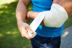 Bandaging arm royalty free stock photography