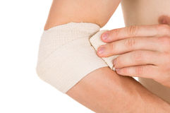 Bandaging the elbow with an elastic bandage Stock Photography