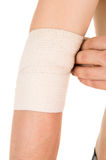 Bandaging the elbow with an elastic bandage Royalty Free Stock Images