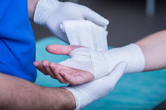 Bandaging a hand Stock Image