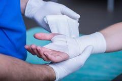 Bandaging a hand Stock Image