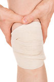 Bandaging the knee with an elastic bandage Stock Images