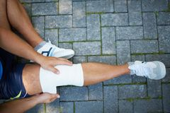 Bandaging leg Royalty Free Stock Images