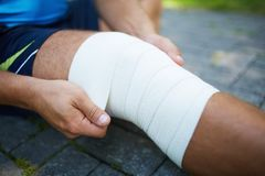 Bandaging leg Royalty Free Stock Photos