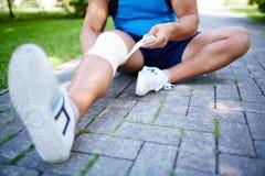 Bandaging leg Royalty Free Stock Images