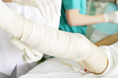 Bandaging of the legs with elastic bandage Stock Image