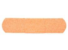 Bandaid. Closeup of adhesive bandaid on isolated white background royalty free stock photo
