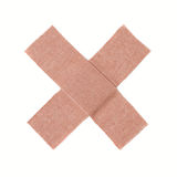 Bandaid. Cross of bandage on white background Royalty Free Stock Photography