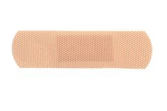 Bandaid. Macro of a skin toned bandage isolated on white background Royalty Free Stock Photos