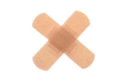 Bandaid. In cross shape, isolated white background Stock Photo