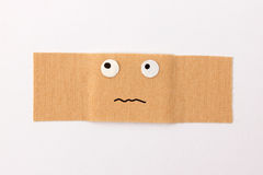 Bandaid with comic face Royalty Free Stock Photography
