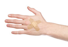 Bandaid on a hand Stock Image