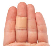 Bandaid on hand Stock Images