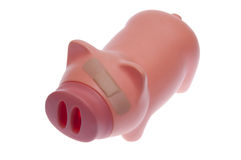 Bandaid on Savings or H1N1. Piggy bank with a bandaid over its eye.  Temporary solution to a financial problem or the H1N1 swine flu.  This is not a healthy pig Royalty Free Stock Photos