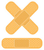 Bandaid on white. Band-aid on white, apply a plaster Royalty Free Stock Image