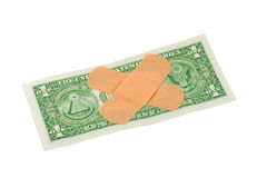 Bandaids on dollar bill Royalty Free Stock Photography