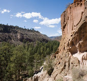 Bandalier panorama three. True wide panorama of Frijoles Canyon, containing Bandalier National Monument, with the Jemez Mountains in the background Royalty Free Stock Photo