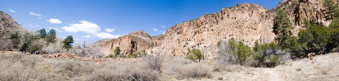 Bandalier panorama two. True wide panorama of Frijoles Canyon, containing Bandalier National Monument, with the ruins in the foreground and canyon walls on the Stock Image