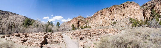 Bandalier panorama two. True wide panorama of Frijoles Canyon, containing Bandalier National Monument, with the ruins in the foreground and canyon walls on the Stock Photos