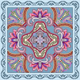 Bandanna with bright colorful paisley on a turquoise background Royalty Free Stock Image