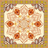 Bandanna with brown orange ornament on beige background. With a border of yellow flowers Stock Photo