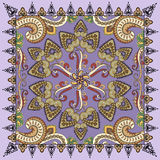 Bandanna with colorful paisley on a purple background Royalty Free Stock Photo