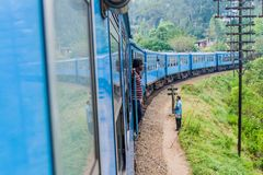 BANDARAWELA, SRI LANKA - JULY 15, 2016: Train rides through mountains in Sri Lan. Ka stock image