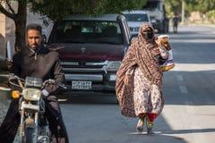 Bandari woman wearing a traditional mask called the burqa, Qeshm Island, Iran Stock Photo