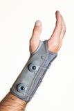 Bandażuje nadgarstek z ciśnieniowym regulatorem na man& x27; s ręka - odizolowywa Obrazy Stock