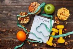 Bande, cahier et céréales de mesure Photo stock