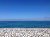 bande de mer, de ciel et de pierre Photos libres de droits