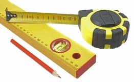 Bande de mesure, construisant de niveau et crayon Photographie stock