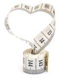 Bande de mesure regardant comme coeur Photographie stock