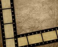 Bande della pellicola su documento grungy Fotografie Stock