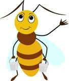 Bande dessinée d'abeille souriant avec deux seaux Image stock