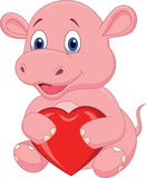 Bande dessinée d'hippopotame tenant le coeur rouge Images stock