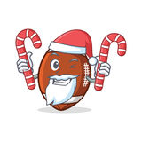 Bande dessinée de caractère du football de Santa American avec la sucrerie Photographie stock