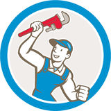 Bande dessinée de cercle de Holding Monkey Wrench de plombier Images stock