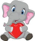 Bande dessinée mignonne d'éléphant tenant le coeur rouge Photo stock