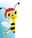 Bande dessinée Santa Bee d'amusement regardant un page blanc vide Photos stock