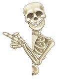 Bande dessinée squelettique jetant un coup d'oeil autour du signe et du pointage Images stock