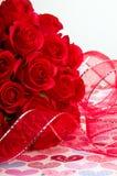 Bande et roses rouges Image stock